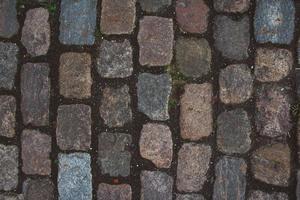 Pavimento de baldosas estampadas camino de adoquines de textura foto