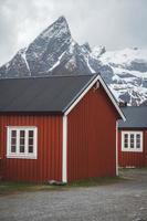 Norway rorbu houses and mountains rocks view Lofoten islands photo