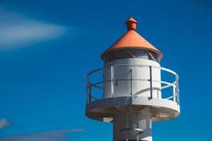Lighthouse on background of blue sky on Lofoten Islands photo