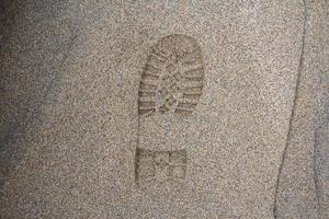 Imprint of the shoe on mud with copy space, Footprint in the dirt photo