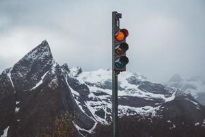 Traffic lights with red turned on the background of mountains photo