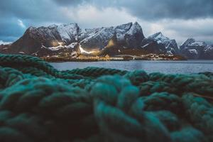 Norway rorbu fishermen's houses in front of the sea and high mountains photo