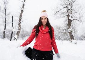 Portrait of a beautiful smiling young woman in wintertime outdoors photo