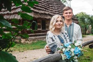 Married couple with bouquet photo