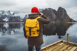 Man talking on phone with a backpack in nature photo