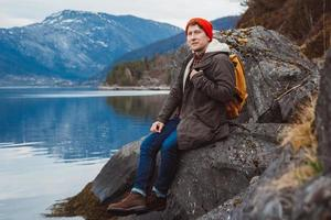 Man sitting on the shore photo