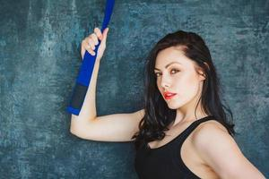 Athletic woman with blue belt photo