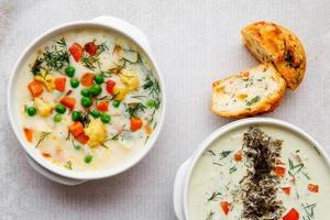 Two bowls of vegetable soup photo