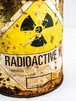 Rusty container of old Radioactive material barrel photo