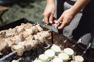 Cooking grilled kebab on metal skewer photo