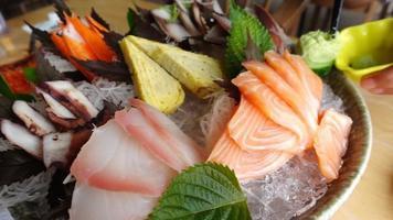 Slow motion closeup pan shot sashimi set video