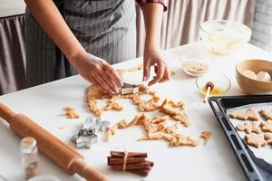 Woman hands baking cookies at the kitchen photo
