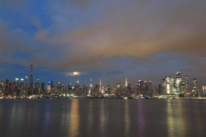 Beautiful Manhattan night view and moon seen from New Jersey photo