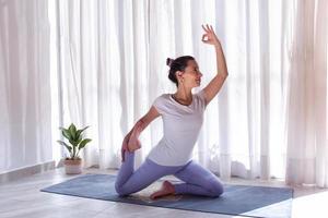 Beautiful woman practicing yoga in a yoga room photo