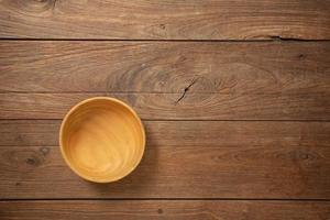 Wooden cookware on Dark old wooden table texture background top view photo