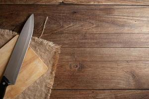 Dark old wooden table texture and knife  top view. photo