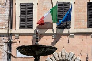 Spoleto town hall with flags photo