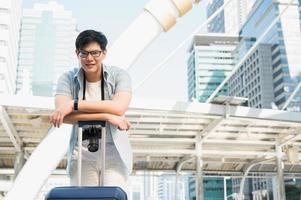 Young Asian traveller handsome man in the urban  city photo
