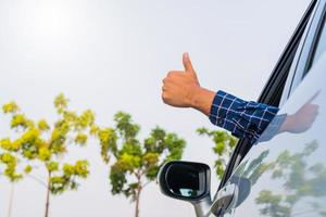 Male hand thumbs up in car photo