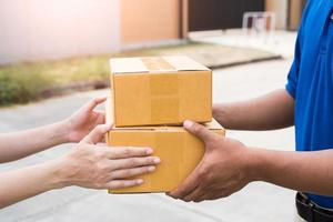 Women hands receiving package from delivery man. photo