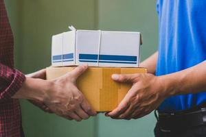 Hand accepting a delivery of boxes from deliveryman. photo