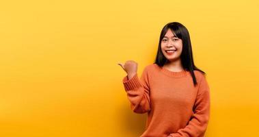 Asian girl Pretty wearing an orange casual dress photo