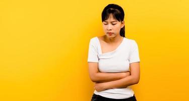 Depressed girl alone sitting still on a yellow photo