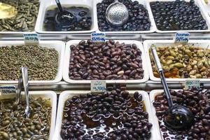 Mixed olive tapas snacks in la boqueria market display trays in Barcelona Spain photo