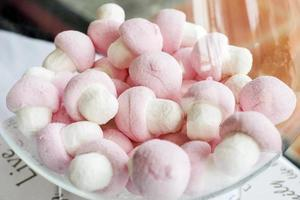 Pink and white candy marshmallows in bowl photo