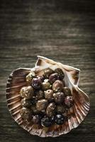 Gourmet garlic and herb marinated fresh olives tapas snack starter photo