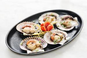 Fresh steamed gourmet scallop with Asian sweet-sour seafood sauce snack photo