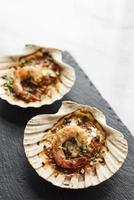 Gourmet cuisine baked king prawns in spicy tomato and herb sauce photo