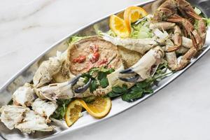 Gourmet fresh whole crab with seafood cream mousse and prawn meal photo