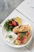 Scandinavian healthy fresh smoked salmon sandwich with egg and sour cream set meal photo