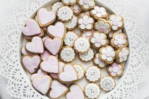 Mixed pink and white glazed cookie biscuits on tray photo