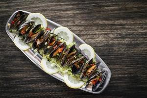 Mussels in fresh zesty marinated citrus vegetable sauce seafood tapas snack photo