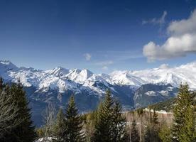 Sunny French alps landscape and snowy mountain view in Les Arcs ski resort near Bourg Saint Maurice France photo