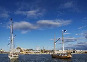Old wooden sailing boats in Helsinki City Central Harbor Port Finland photo