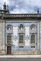 Traditional Portuguese Azulejo tiles on Carmo church exterior in Porto Portugal photo