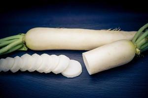 Radish the long white root vegetable photo