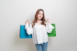 Asian woman holding shopping bag photo