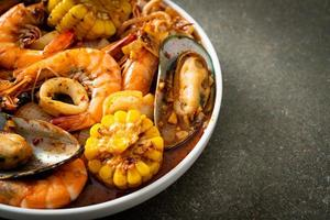 Spicy barbecue seafood - shrimps, sqiud, mussel photo