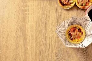 Tasty egg tart pizza on wooden backgrounds concept photo