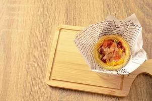 Egg tart pizza on wooden plate backgrounds photo