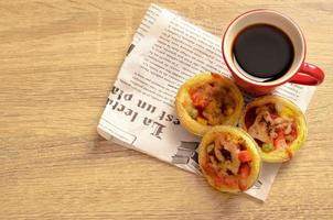 Tasty homemade egg tart pizza with hot coffee at home concept photo