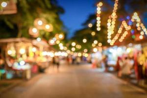 Bokeh night market in thailand. Ayutthaya vintage shopping street. photo