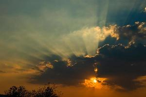 Beautiful sky with clouds and sun rays photo
