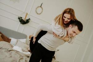 Young couple in love, smiling and fooling around photo