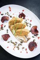 Gourmet fish fillet with chickpea curry puree and beetroot chips meal photo