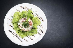 Gourmet prawn cocktail salad with apple celery and spicy yogurt sauce photo